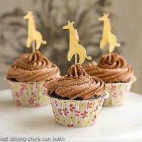 Cocoa Cupcakes with Chocolate Buttercream in floral paper wrappers with a giraffe topper