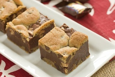 A  tray of fudge and toffee filled chocolate chip bars