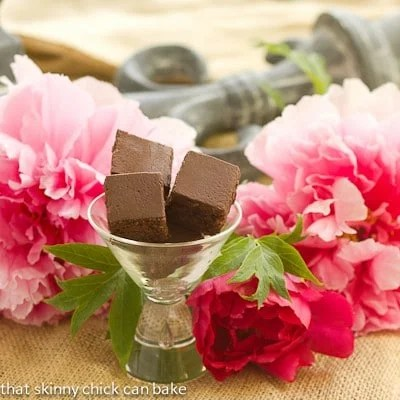 Refrigerator Brownies in a martini glass with peonies surrounding them