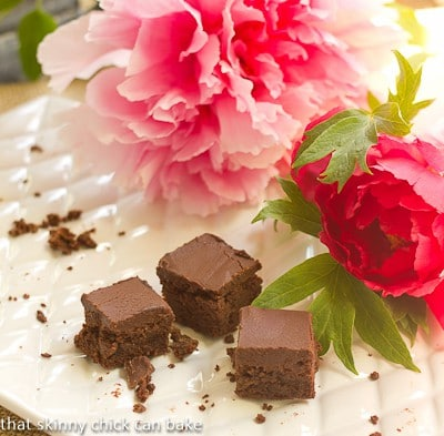 A nearly empty platter of Refrigerator Brownies with some pink peonies