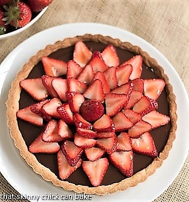 Overhead view of a Chocolate Tart with Strawberries on a serving plate