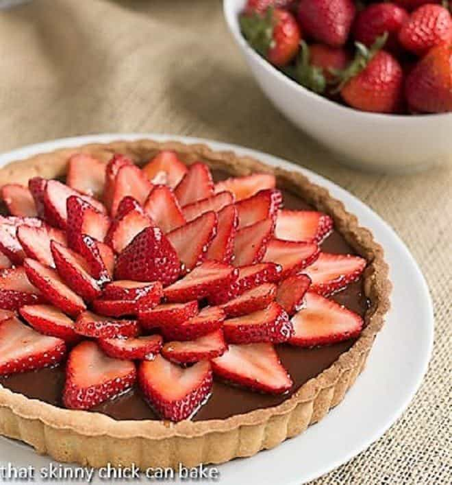 Strawberry Topped Chocolate Tart on a white serving plate