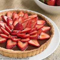 Strawberry Topped Chocolate Tart on a white ceramic plate