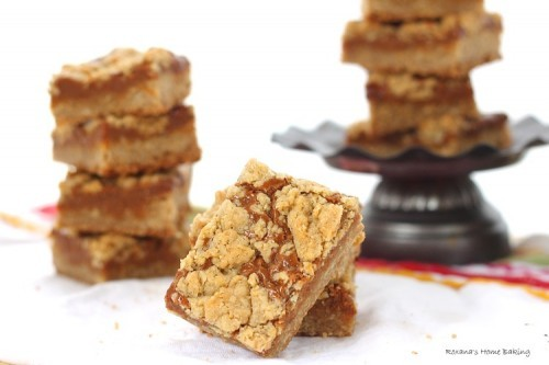 dulce de leche bars stacked and on a small pedestal