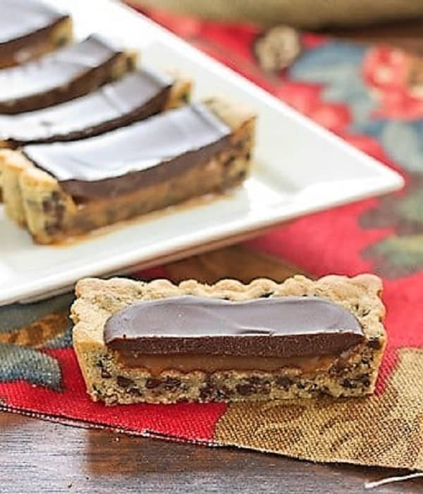 Sliced Chocolate Chip Cookie Tart on a white ceramic tray