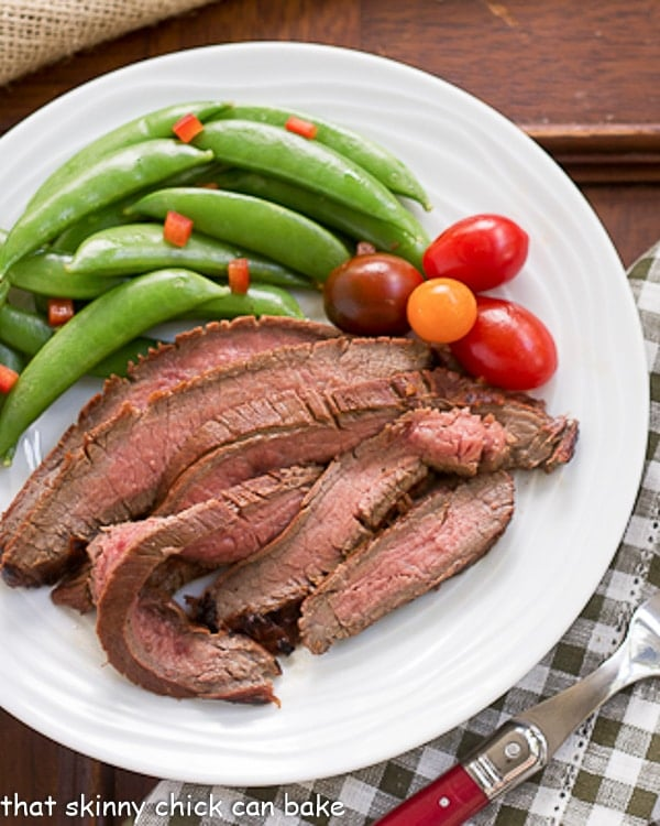 Overhead view of Korean Grilled Flank Steak slices and vegetables