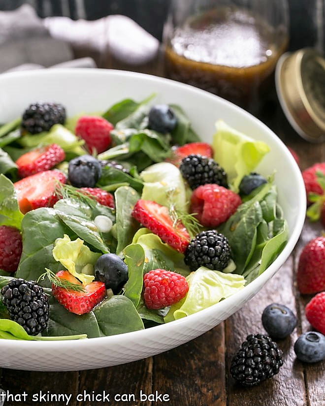 Spinach Almond and Berries Salad in a white serving bowl