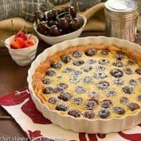 Whole-Cherry Clafoutis in a white ceramic tart dish