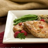 Raspberry chicken on a square plate