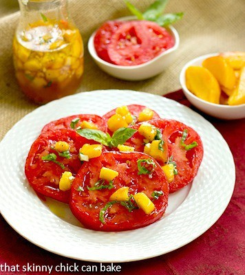 Tomato Salad with Peach and Basil Vinaigrette on a white plate
