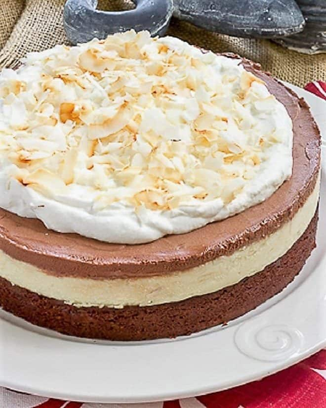 Coconut Brownie Cake on a white cake plate