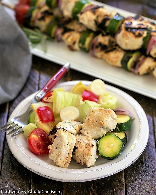 Feta Chicken Kabobs with a salad on a white plate