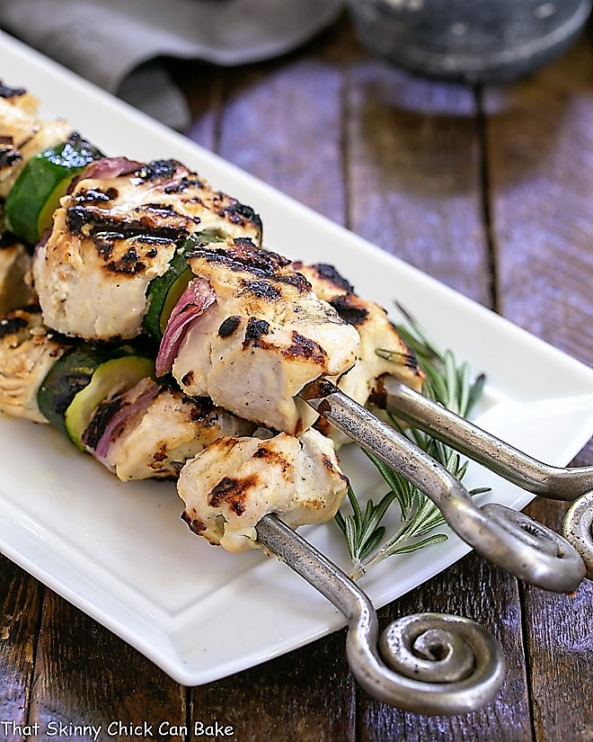 Grilled Feta Chicken Kabobs on a white serving tray
