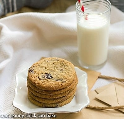 Ad Hoc Brown Sugar Chocolate Chip Cookies stacked on a square white plate with a glass of milk
