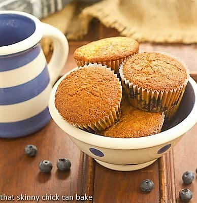 Sour Cream Blueberry Muffins in a white ceramic bowl with blue polka dots
