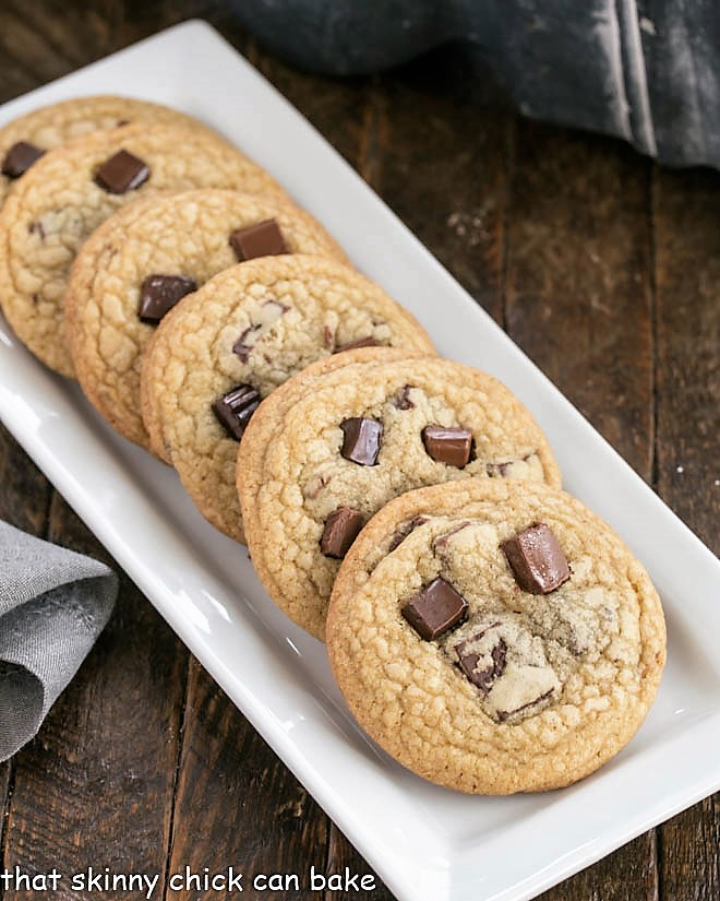 Brown Sugar Chocolate Chunk Cookies lined up on a narrow white tray