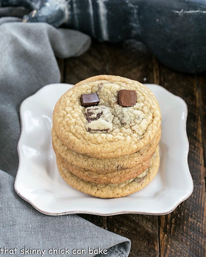 Stack of Brown Sugar Chocolate Chunk Cookies on a square white plate