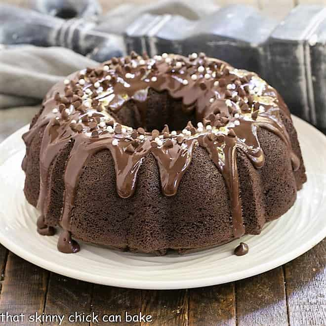 Chocolate Sour Cream Bundt Cake on a white cake plate