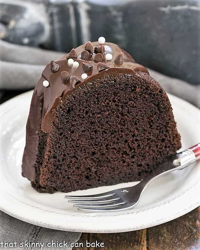 Slice of Chocolate Sour Cream Bundt Cake on a white plate