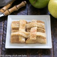 Slice of apple slab pie on a square white plate