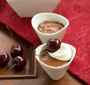 Egg Free Chocolate Mousse in white ramekins with fresh cherries