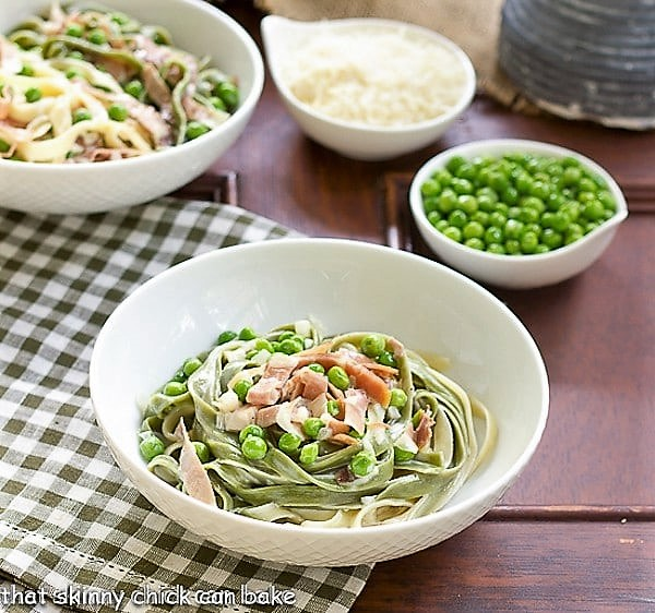 Straw and Hay Pasta in a white bowl on a green and white checkered napkin