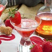 Strawberry Bellinis garnished with frresh strawberries