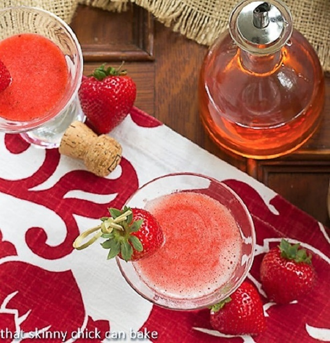 Overhead view of Strawberry Bellinis on a red and white napkin