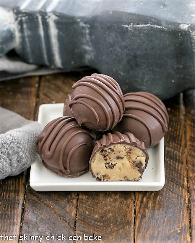 Stack of cookie dough truffles on a square white plate