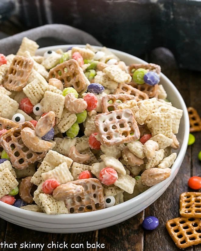 Halloween Chex Mix in a white serving bowl