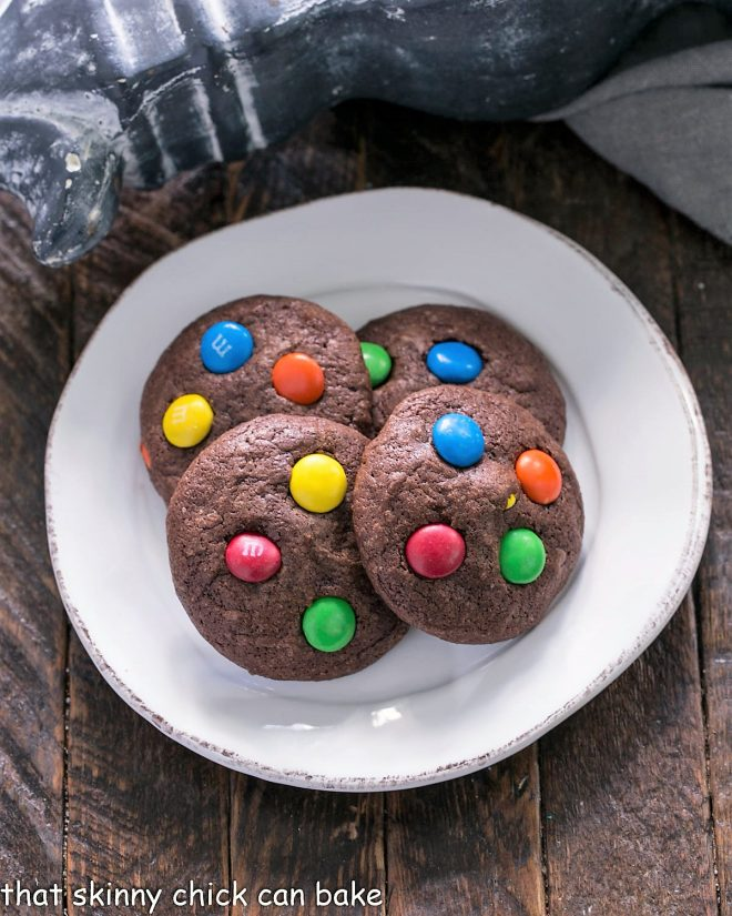 Overhead view of 4 Brownie cookies on a round white plate