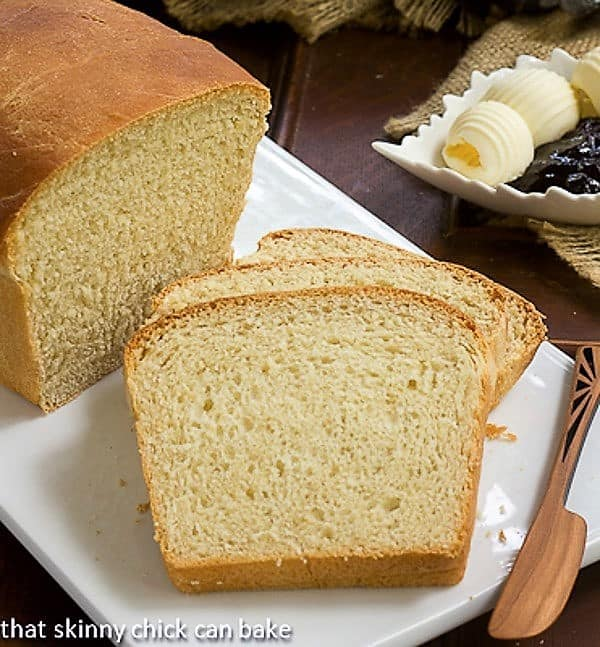 Homemade Potato Bread slices on a white cutting board