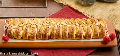 Horizontal view of Raspberry Danish Braid on a cutting board