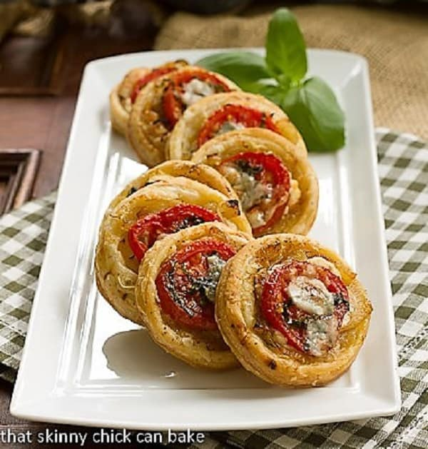 Tomato and Boursin Tartlets on a white ceramic tray