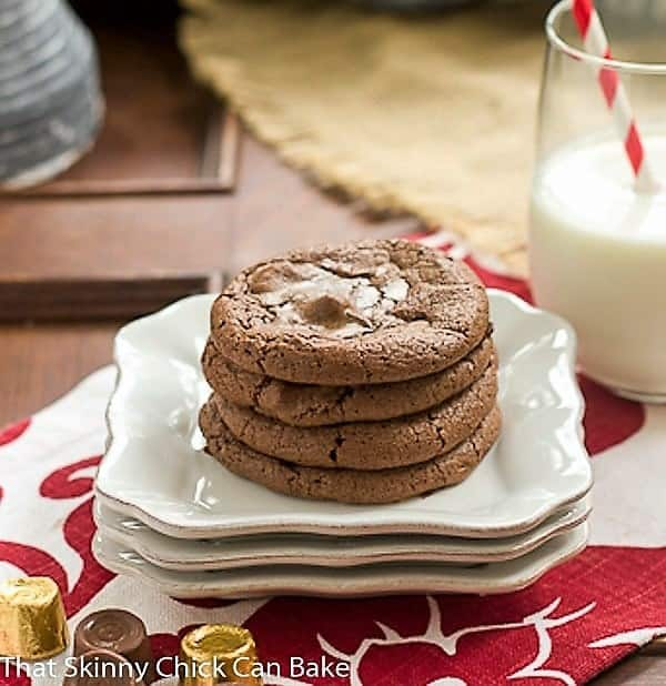 Rolo Brownie Cookies stacked on white dessert plates