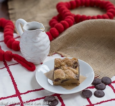 One Caramel Chocolate Chip Cookie Bar on a small white plate