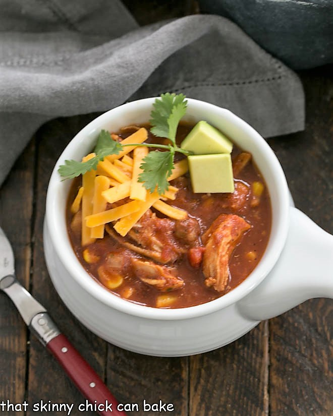 Overhead view of chicken tortilla soup in a white soup bowl