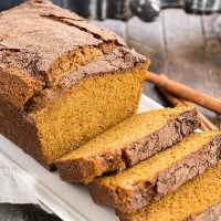 A partially sliced loaf of a pumpkin bread recipe
