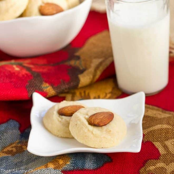 Ghraybeh or Lebanese Shortbread Cookies on a small white plate and in a white bowl