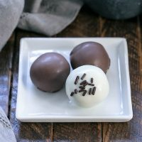 3 Oreo truffles on a square white plate