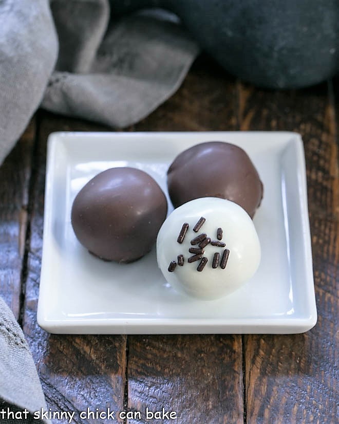 3 Oreo truffles on a square white plate