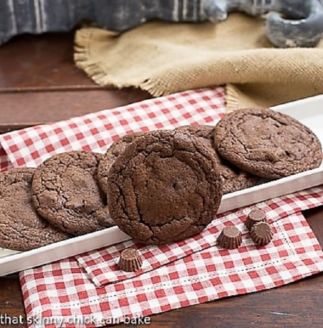 Peanut Butter Filled Chocolate Cookies on a white tray over a checked napkin