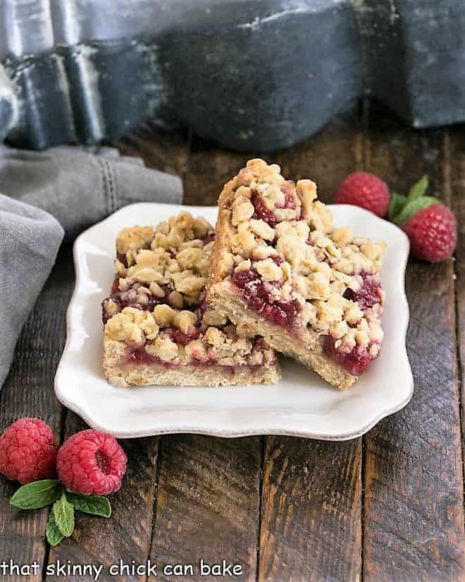 2 raspberry Oatmeal Bars on a white dessert plate