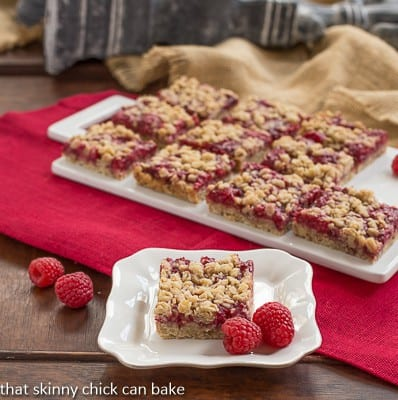 Raspberry Streusel Bars - Scrumptious berry bars with a melt in your mouth crumb topping!