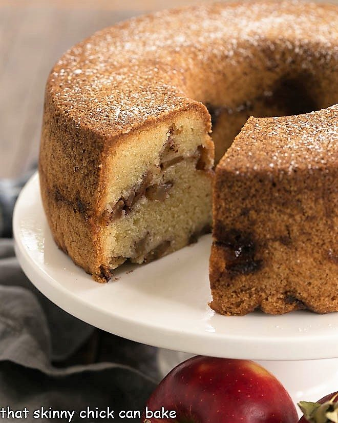 Cinnamon Apple Bundt Cake on a white cake stand
