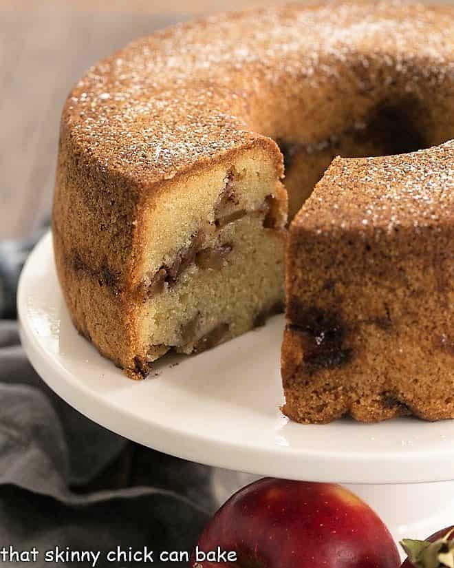 Cinnamon Apple Bundt Cake on a white cake stand