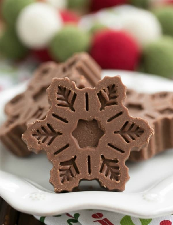 Festive Fudge Snowflakes on a white plate