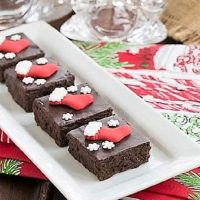 Fudgy red wine brownies with Christmas sprinkles on a white tray