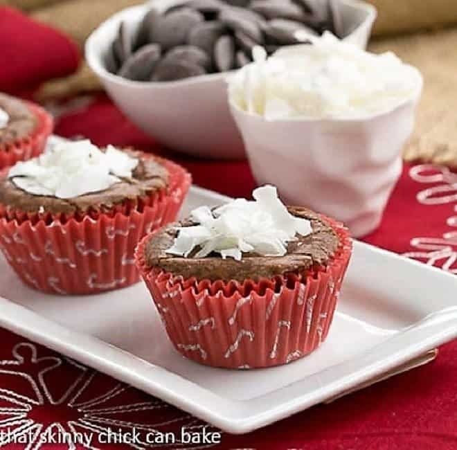 Mounds Brownie Cupcakes in red cupcake liners on a white tray