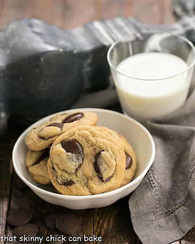 Southern Living's BEST Chocolate Chip Cookies in a white bowl next to a glass of milk